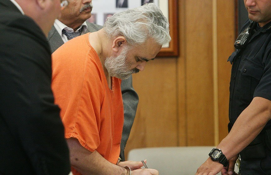 Defendant signing paper in court
